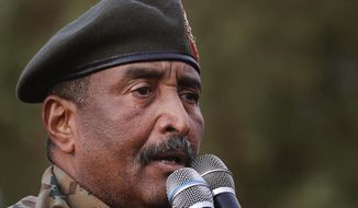 """Sudanese Gen. Abdel-Fattah Burhan, head of the military council, speaks during a military-backed rally, in Omdurman district, west of Khartoum, Sudan, Saturday, June 29, 2019. Sudan's ruling military council on Saturday warned protest leaders of """"destruction or damage"""" ahead of planned mass rallies over the weekend calling for civilian rule over two months after the military ouster of autocratic president Omar al-Bashir. (AP Photo/Hussein Malla)"""