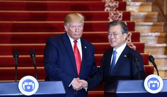 President Donald Trump, left, and South Korean President Moon Jae-in shake hands following their news conference at the Blue House in Seoul, Sunday, June 30, 2019. (AP Photo/Susan Walsh)