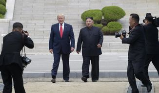 President Donald Trump and North Korean leader Kim Jong Un walk on the North Korean side at the border village of Panmunjom in the Demilitarized Zone, Sunday, June 30, 2019. (AP Photo/Susan Walsh)