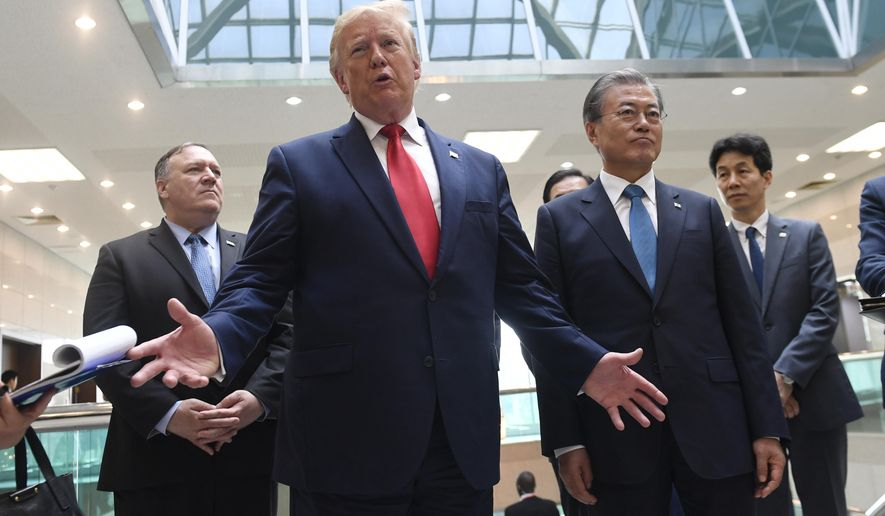 President Donald Trump talks to the media with South Korean President Moon Jae-in, right, and Sec. of State Mike Pompeo, rear left, at the border village of Panmunjom in the Demilitarized Zone, South Korea, Sunday, June 30, 2019 after he met with North Korean leader Kim Jong Un. (AP Photo/Susan Walsh)