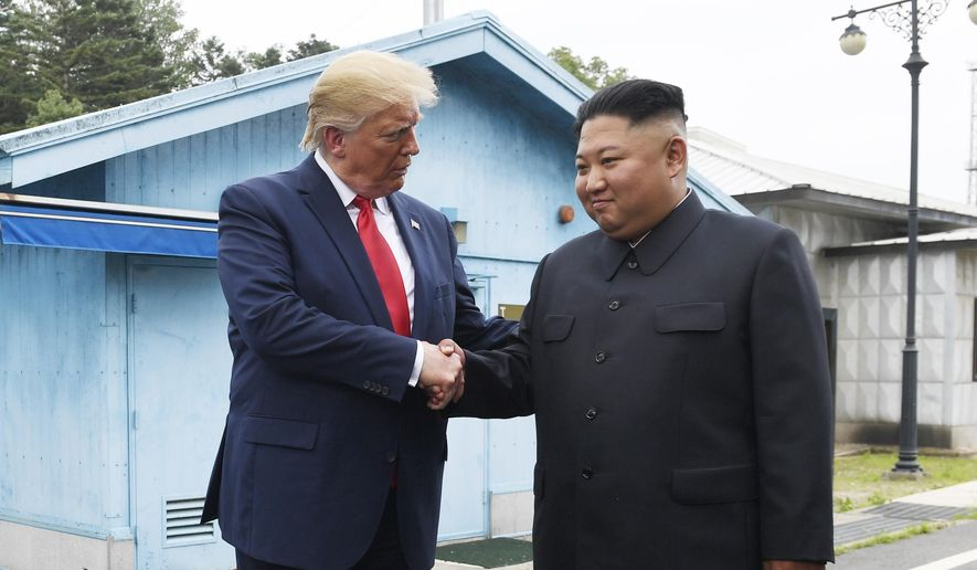 President Donald Trump meets with North Korean leader Kim Jong-un at the border village of Panmunjom in the Demilitarized Zone, South Korea, Sunday, June 30, 2019. (AP Photo/Susan Walsh)