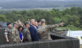 President Donald Trump views North Korea from the Korean Demilitarized Zone from Observation Post Ouellette at Camp Bonifas in South Korea, Sunday, June 30, 2019. (AP Photo/Susan Walsh)