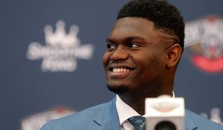 New Orleans Pelicans first-round NBA draft pick Zion Williamson smiles at his introductory news conference at the team's practice facility in Metairie, La., Friday, June 21, 2019. (AP Photo/Gerald Herbert)