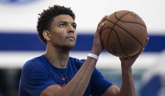Philadelphia 76ers' Matisse Thybulle runs a drill during the NBA basketball team's minicamp in Camden, N.J., Monday, July 1, 2019. (AP Photo/Matt Rourke)