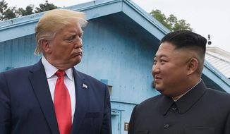 President Donald Trump meets with North Korean leader Kim Jong-un at the border village of Panmunjom in Demilitarized Zone, South Korea, Sunday, June 30, 2019. (Associated Press)