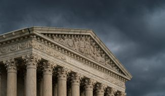The Supreme Court is seen under stormy skies in Washington, Thursday, June 20, 2019. (AP Photo/J. Scott Applewhite) (Associated Press) **FILE**