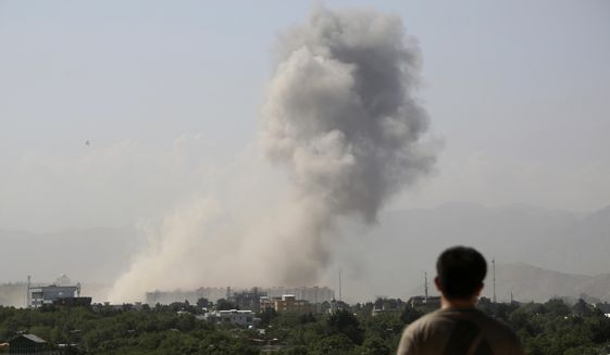 Smoke rises after a huge explosion in Kabul, Afghanistan, Monday, July 1, 2019. Powerful explosion rocks Afghan capital, with smoke seen billowing from downtown area near U.S. Embassy. (AP Photo/Rahmat Gul) **FILE**