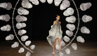 A model wears a creation for Iris van Herpen Haute Couture Fall-Winter 2019-2020 fashion collection presented in Paris, Monday, July 1 2019. (AP Photo/Francois Mori)