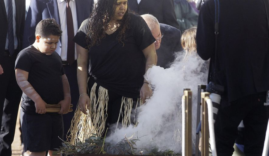 Indigenous people hold a ceremony to welcome lawmakers to the first sitting of the Australian Parliament in Canberra since the May election, on Tuesday, July 2, 2019. The Australian government returned to Parliament on Tuesday claiming a new mandate from the May election to pass 158 billion Australian dollars ($110 billion) in tax cuts into law. (AP Photo/Rod McGuirk)