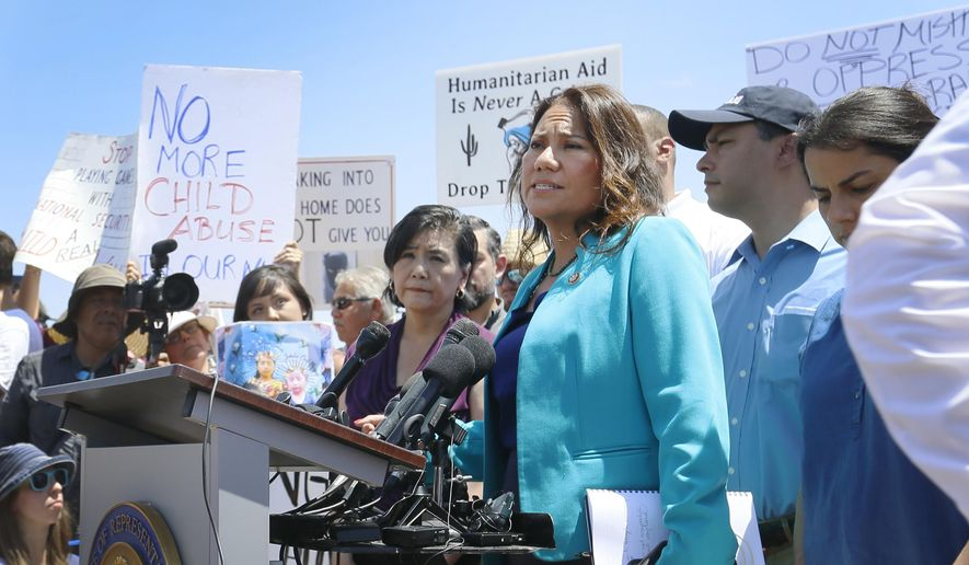 U.S. Rep. Veronica Escobar, D-El Paso, member of the House Judiciary Committee and freshman representative of the Hispanic Caucus, talks about what she saw on her tour of area border facilities Monday, July 1, 2019, at the Border Patrol station in Clint. Escobar was attempting to talk over the protesters. (Briana Sanchez / El Paso Times via AP) ** FILE **