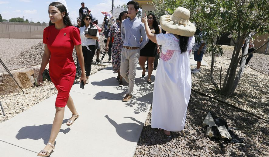 U.S. Rep. Alexandria Ocasio-Cortez, D-New York, walks to the front of the Clint Border Patrol station to talk about what she saw at area border facilities Monday, July 1, at the station in Clint. (Briana Sanchez/El Paso Times via AP)