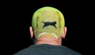 A tennis fan with his hair dyed the colour of a Slazenger ball on day one of the Wimbledon Tennis Championships in London, Monday July 1, 2019. (Mike Egerton/PA via AP)