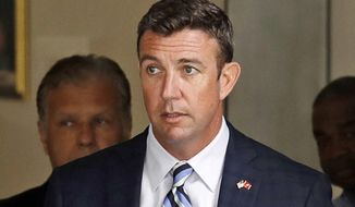 FILE - In this Aug. 23, 2018, file photo, Republican U.S. Rep. Duncan Hunter, R-Calif., leaves an arraignment hearing in San Diego after he and his wife, Margaret, pleaded not guilty to charges they illegally used his campaign account for personal expenses. Hunter is charged with looting his own campaign cash to finance vacations, golf and other personal expenses, then trying to cover it up. The Republican congressman says he's the target of politically biased prosecutors. A federal judge in San Diego is scheduled Monday, July 1, 2019, to consider if Hunter is right. (AP Photo/Gregory Bull, File)