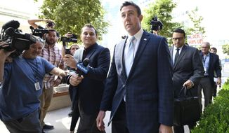 U.S. Rep. Duncan Hunter, R-Calif., leaves federal court after a hearing, Monday, July 1, 2019, in San Diego. Hunter is charged with looting his own campaign cash to finance vacations, golf and other personal expenses, then trying to cover it up. The Republican congressman says he's the target of politically biased prosecutors. (AP Photo/Denis Poroy)