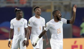 Ivory Coast's Die Serey, right, celebrates with teammates after scoring his side's second goal during the African Cup of Nations group D soccer match between Namibia and Ivory Coast in 30 June Stadium in Cairo, Egypt, Monday, July 1, 2019. (AP Photo/Hassan Ammar)
