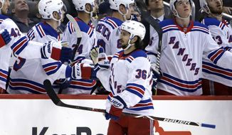 FILE - In this Feb. 17, 2019, file photo, New York Rangers' Mats Zuccarello (36) celebrates his goal as he returns to the bench during the second period of an NHL hockey game against the Pittsburgh Penguins in Pittsburgh. The Minnesota Wild have signed free agent right wing Mats Zuccarello to a five-year, $30 million contract, seeking more consistent production from their top two lines after their streak of six straight trips to the playoffs was snapped this spring.(AP Photo/Gene J. Puskar, File)