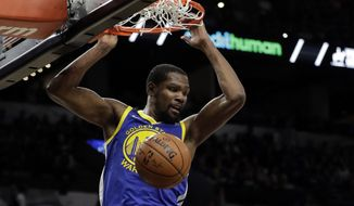 In this April 19, 2018, file photo, Golden State Warriors forward Kevin Durant dunks as San Antonio Spurs' Rudy Gay (22) watches during the the first half of Game 3 of a first-round NBA basketball playoff series in San Antonio.  Just three seasons ago, the Brooklyn Nets were the worst team in the NBA. On Sunday, June 30, 2019, they were the story of the league. They agreed to deals with superstars Kevin Durant and Kyrie Irving as part of a sensational start to free agency, giving the longtime No. 2 team in New York top billing in the Big Apple. (AP Photo/Tony Gutierrez, File) **FILE**