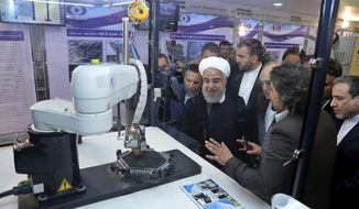 """In this April 9, 2018, file photo, released by an official website of the office of the Iranian Presidency, President Hassan Rouhani listens to explanations on new nuclear achievements at a ceremony to mark """"National Nuclear Day,"""" in Tehran, Iran. Iranian Foreign Minister Mohammad Javad Zarif acknowledged Monday, July 1, 2019, Iran had broken the limit set on its stockpile of low-enriched uranium by the 2015 nuclear deal, marking its first major departure from the unraveling agreement a year after the U.S. unilaterally withdrew from the accord.  (Iranian Presidency Office via AP) ** FILE **"""