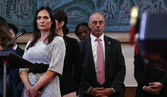 White House press secretary Stephanie Grisham, left, attends a news conference by President Donald Trump and South Korean President Moon Jae-in at Blue House in Seoul, South Korea, Sunday, June 30, 2019, before heading to the demilitarized zone. (AP Photo/Jacquelyn Martin, Pool)