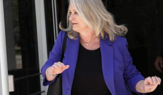 Mississippi Department of Mental Health Director Diana Mikula exits the federal courthouse in Jackson, Miss., Monday, July 1, 2019, after closing arguments were presented on whether Mississippi's mental health system breaks the law by unnecessarily confining people. The U.S. Justice Department urged a judge to order changes saying Mississippi's move toward providing community services is far too slow, forcing people into hospital stays that could be avoided. While attorneys for the state argue Mississippi is progressing on its own. (AP Photo/Rogelio V. Solis)