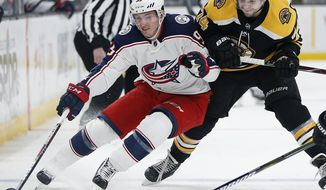 FILE - In this March 16, 2019, file photo, Columbus Blue Jackets' Matt Duchene, left, battles Boston Bruins' Jake DeBrusk (74) for the puck during the first period of an NHL hockey game in Boston. A person with direct knowledge of the agreement says the Nashville Predators have added free agent forward Matt Duchene after agreeing to terms on a seven-year contract worth $56 million. The person spoke to The Associated Press on condition of anonymity because the deal hasn't been officially announced. (AP Photo/Michael Dwyer, File)