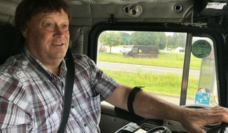 Truck driver Terry Button drives his truck near Opal, Va., Thursday, June 13, 2019. The Transportation Department is poised to relax the federal regulations that govern how many hours a day truckers can be behind the wheel, a long sought goal of the trucking industry.  (AP Photo/Tom Sampson)