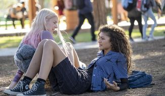 "This image released by HBO shows Zendaya, right, and Hunter Schafer in a scene from ""Euphoria"" airing Sundays at 10 p.m. ET on HBO. (Eddy Chen/HBO via AP) **FILE**"