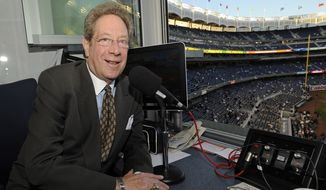 In this photo taken on Friday, Sept. 25, 2009, New York Yankees broadcaster John Sterling sits his booth before a baseball game against the Boston Red Sox at Yankee Stadium in New York. Sterling has been the distinctive voice of the Yankees for 20 years, the heir to one of the most coveted and influential seats in sports radio.(AP Photo/Bill Kostroun)