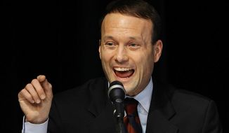 Illinois Republican gubernatorial candidate Adam Andrzejewski jokes about having his name misspelled on a sign during a debate between the Illinois Republican candidates for Governor in Springfield, Ill., Monday, Dec 14, 2009. (AP Photo/Seth Perlman) ** FILE **