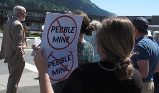 This June 25, 2019, photo shows people gathered outside U.S. Sen. Lisa Murkowski's office in Juneau, Alaska, to protest the proposed Pebble Mine. During a comment period that ended Monday, July 1, 2019, a U.S. Environmental Protection Agency official cited concerns with a draft environmental review the U.S. Army Corps of Engineers has done on the project. (AP Photo/Becky Bohrer)
