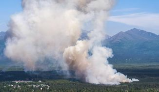 A brush fire burns in South Anchorage, Alaska, Tuesday, July 2, 2019. (Loren Holmes/Anchorage Daily News via AP)