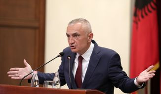 "Albania's president Ilir Meta speaks during a press conference in Tirana, Tuesday, July 2, 2019. Meta has strongly denounced the June 30 municipal elections as a ""farce"" after they were boycotted by the opposition, and has proposed new elections in October to resolve the political crisis. (AP Photo/Hektor Pustina)"