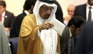 Khalid Al-Falih, Minister of Energy, Industry and Mineral Resources of Saudi Arabia stands prior to the start of a meeting the Organization of the Petroleum Exporting Countries, OPEC, at their headquarters in Vienna, Austria, Monday, July 1, 2019. (AP Photo/Ronald Zak)