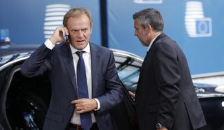 European Council President Donald Tusk arrives for an EU summit in Brussels, Tuesday, July 2, 2019. European Union leaders continued a third day of talks to seek a breakthrough in a diplomatic fight over who should be picked for a half dozen of jobs at top EU institutions. (Geoffroy van der Hasselt, Pool Photo via AP)