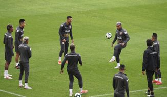 Peru's soccer players warm up during a practice session in Porto Alegre, Brazil, Monday, July 1, 2019. Peru will face Chile on July 3 in the semifinals for the Copa America. (AP Photo/Edison Vara)