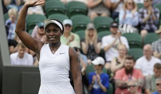 United States' Sloane Stephens celebrates after beating Switzerland's Timea Bacsinszky in a Women's singles match during day two of the Wimbledon Tennis Championships in London, Tuesday, July 2, 2019. (AP Photo/Kirsty Wigglesworth)