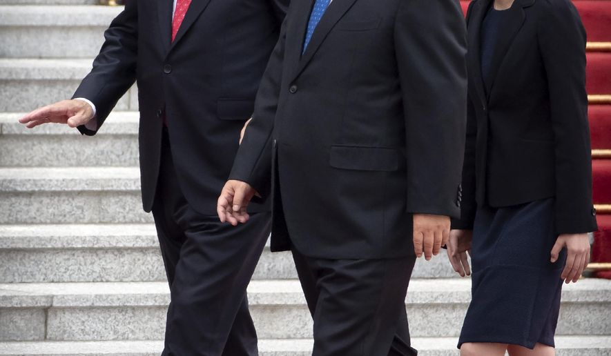Turkish President Recep Tayyip Erdogan, left, walks with Chinese President Xi Jinping during a welcome ceremony at the Great Hall of the People in Beijing, Tuesday, July 2, 2019. (AP Photo/Mark Schiefelbein)