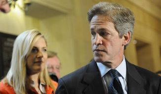 FILE - In a June 1, 2009 file photo, former Sen. Norm Coleman addresses a question  after the Minnesota Supreme Court heard oral arguments in the disputed U.S. Senate race between Republican Coleman and Democrat Al Franken, in St Paul, Minn. Former U.S. Sen. Norm Coleman said Tuesday, July 2, 2019 that he will have surgery on July 15 to have part of his lungs removed after a re-emergence of cancer. Coleman posted on his Facebook page Tuesday that he will have surgery on July 15. (AP Photo/Jim Mone, File)