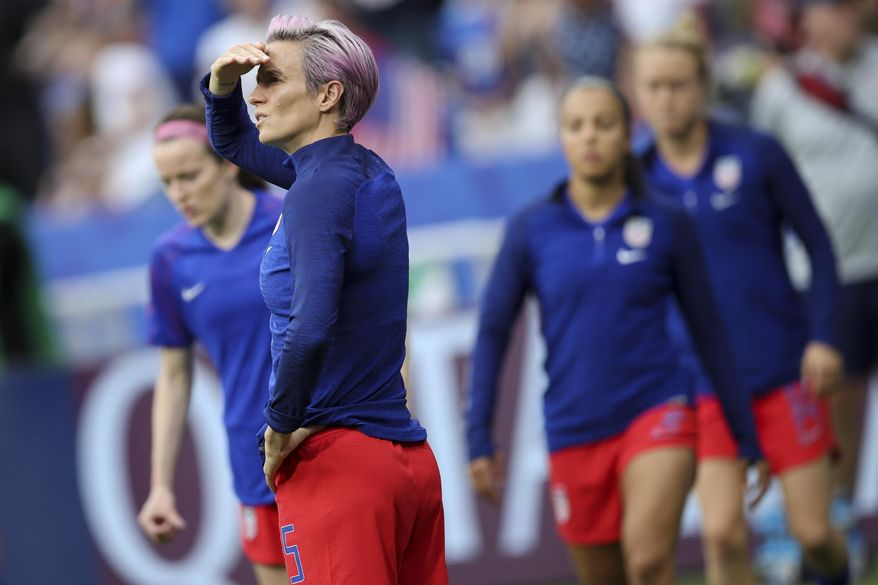 United States' Megan Rapinoe warms up before the Women's World Cup semifinal soccer match between England and the United States, at the Stade de Lyon outside Lyon, France, Tuesday, July 2, 2019. (AP Photo/Francisco Seco) **FILE**