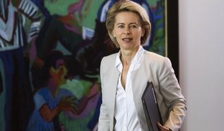 FILE-In this Aug. 2, 2017 file photo German Defense Minister Ursula von der Leyen arrives for the cabinet meeting of the German government at the chancellery in Berlin.  EU leaders reconvened Tuesday July 2, 2019, for a formal summit to consider a list of top job candidates that may have Ursula von der Leyen becoming president of the executive European Commission. (AP Photo/Markus Schreiber, file)