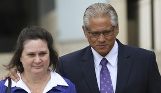 FILE - In this June 25, 2019, file photo, former Honolulu police chief Louis Kealoha, right, and his wife, former deputy prosecutor Katherine Kealoha, walk out of federal court in Honolulu. A defense attorney filed a motion Tuesday, July 2, 2019, asking to withdraw as attorney for Katherine Kealoha, a former Honolulu prosecutor convicted of conspiracy. (AP Photo/Caleb Jones, File)