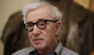 Director Woody Allen attends a press conference at La Scala opera house, in Milan, Italy, Tuesday, July 2, 2019. Woody Allen is directing Puccini's 'Gianni Schicchi' opera, which opens Saturday in Milan. The opera premiered in Los Angeles and it's making its debut at La Scala. (AP Photo/Luca Bruno)