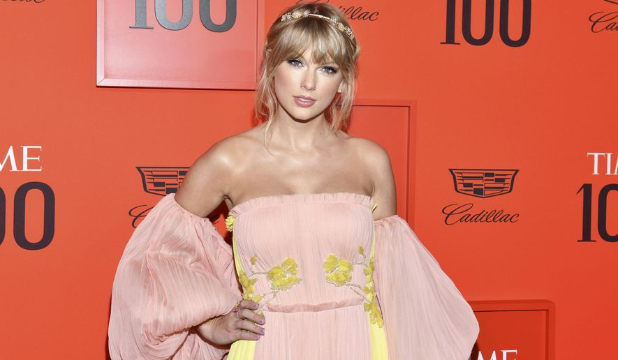 """FILE - This April 23, 2019 file photo shows Taylor Swift at the Time 100 Gala, celebrating the 100 most influential people in the world in New York. Scooter Braun's Ithaca Holdings acquired Big Machine Label Group, home to Swift's first six albums, including the Grammy winners for album of the year, 2008's """"Fearless"""" and 2014's """"1989."""" (Photo by Charles Sykes/Invision/AP, File)"""