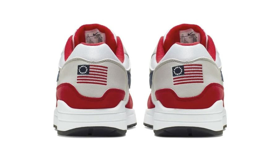 This undated product image obtained by The Associated Press shows Nike Air Max 1 Quick Strike Fourth of July shoes that have a U.S. flag with 13 white stars in a circle on it, known as the Betsy Ross flag, on them. Nike is pulling the flag-themed tennis shoe after former NFL quarterback Colin Kaepernick complained to the shoemaker, according to the Wall Street Journal. (AP Photo)