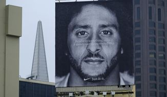 In this Sept. 5, 2018, photo, a large billboard stands on top of a Nike store showing former San Francisco 49ers quarterback Colin Kaepernick, at Union Square in San Francisco. Nike is pulling a flag-themed tennis shoe after Mr. Kaepernick complained to the shoemaker, according to The Wall Street Journal. (AP Photo/Eric Risberg, File)