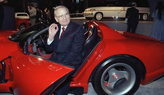 FILE - In this March 28, 1990, file photo, Chrysler Corporation Chairman Lee Iacocca sits in a 1990 Dodge Viper sports car as the Chrysler in the 90's six city tour makes a visit to New York. Former Chrysler CEO Iacocca, who became a folk hero for rescuing the company in the '80s, has died, former colleagues said Tuesday, July 2, 2019. He was 94. (AP Photo/Osamu Honda, File)