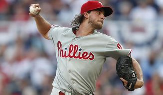 Philadelphia Phillies starting pitcher Aaron Nola works in the first inning of the team's baseball game against the Atlanta Braves on Tuesday, July 2, 2019, in Atlanta. (AP Photo/John Bazemore)