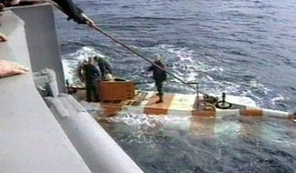 In this video grab provided by the RU-RTR Russian television via APTN , Russia rescue personnel return from a dive in a mini submarine to the Kursk on the sea bed in the Barents Sea, Russia. The Russian military says that a fire on one of its deep-sea submersibles has killed 14 sailors. The Defense Ministry says that the blaze erupted Monday while the vessel was performing tests in Russia's territorial waters. (RU-RTR Russian Television via AP)
