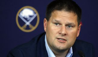 FILE - In this June 25, 2018, file photo, Buffalo Sabres general manager Jason Botterill addresses the media during a NHL news conference in Buffalo N.Y. Realizing how difficult it is to lure free agents to Buffalo, Sabres general manager Jason Botterill has relied mostly on trades to stock his roster with established talent. (AP Photo/Jeffrey T. Barnes, File)