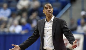 In this Feb. 15, 2018, file photo, Connecticut head coach Kevin Ollie reacts during the second half an NCAA college basketball game against Tulsa in Hartford, Conn. UConn will find out what penalties it faces for violations of NCAA rules in its basketball program under former coach Kevin Ollie. The NCAA Division I Committee on Infractions plans to release its report Tuesday, July 2, 2019. (AP Photo/Jessica Hill, File) **FILE**
